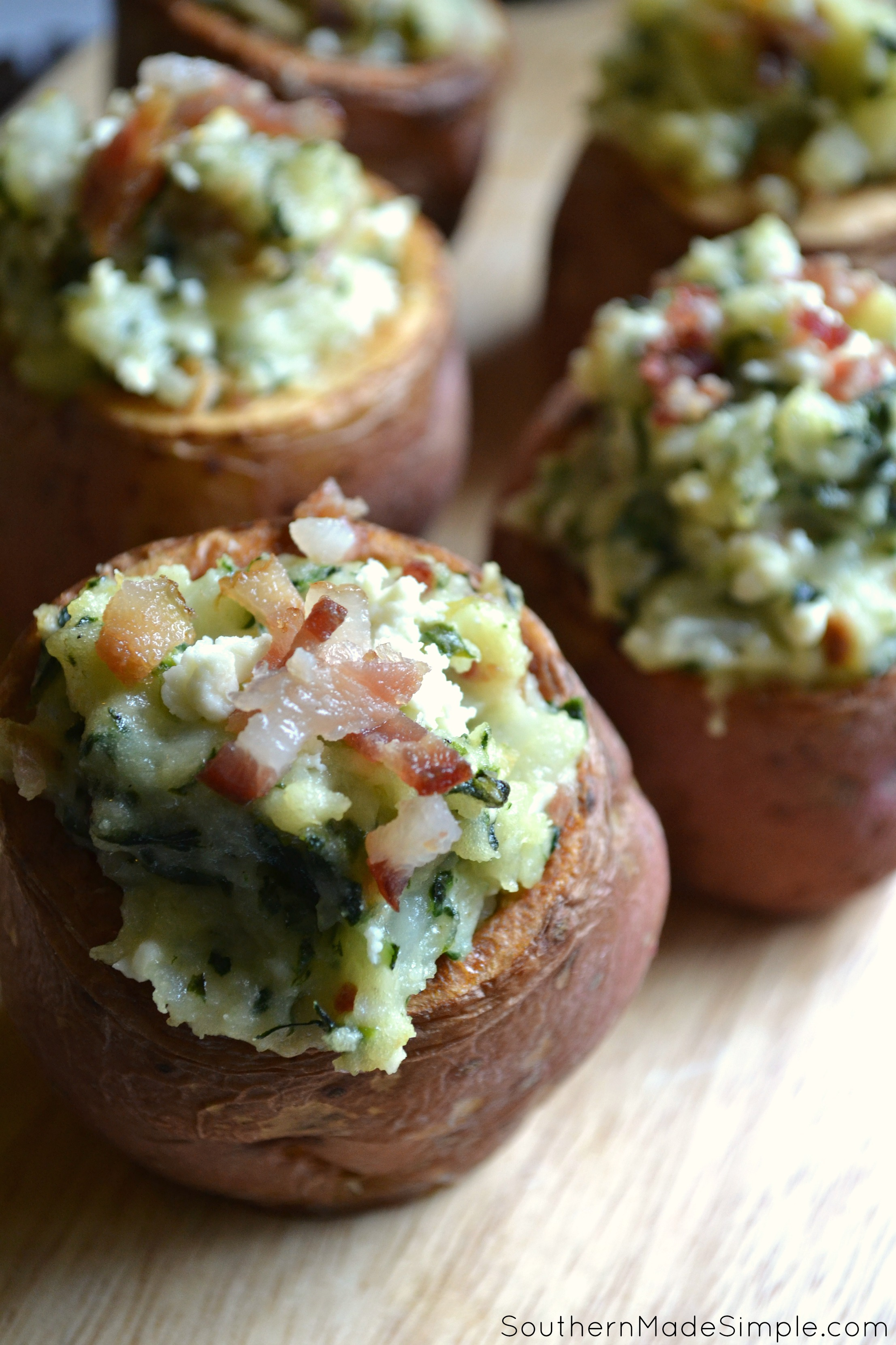 Spinach and Bacon Alfredo Twice Baked Potatoes   This recipe called for red potatoes, so it makes a perfect bit sized appetizer! (Or you can totally make a meal out of it, too!)