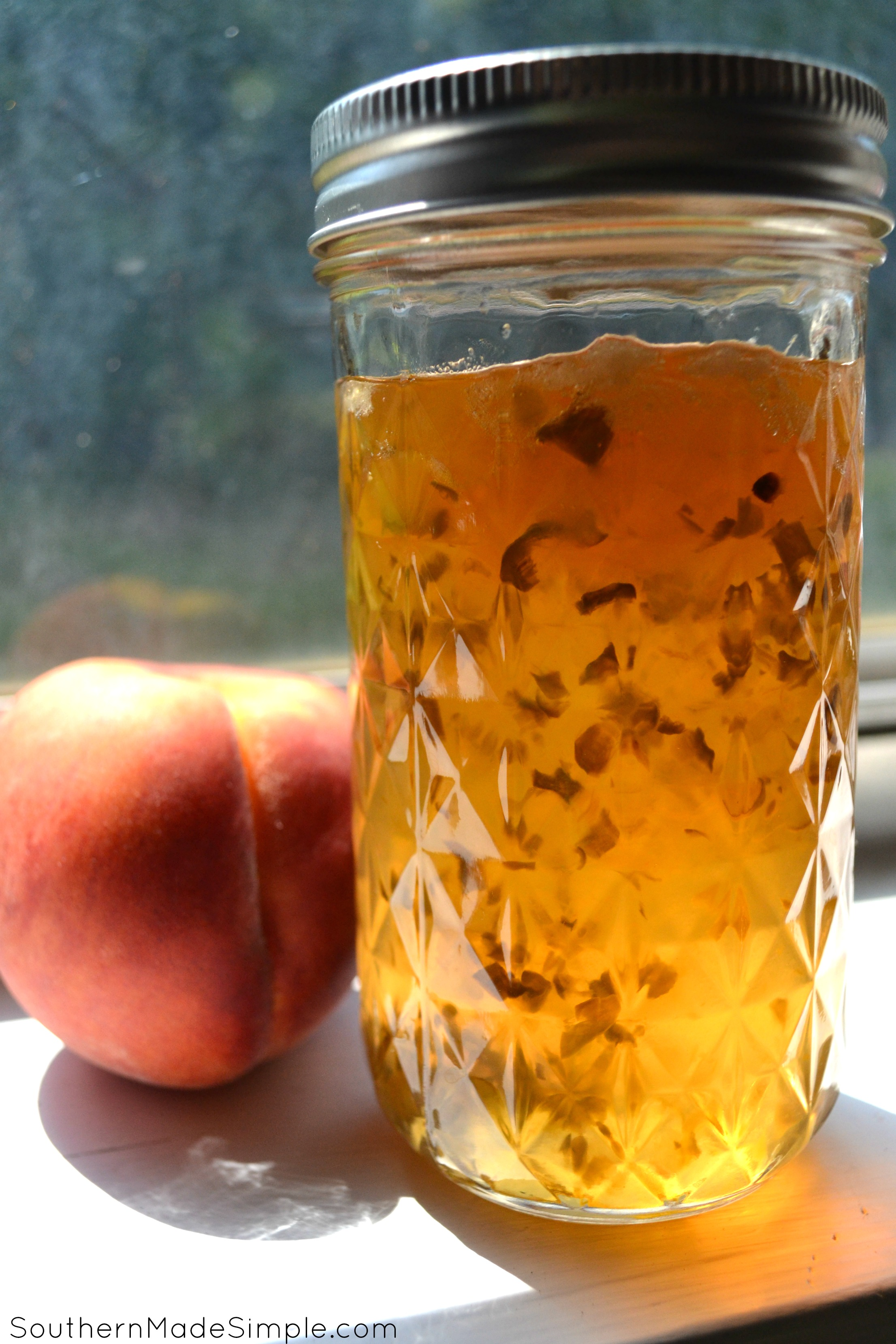 Jalapeno Peach Pepper Jelly - This recipe uses 3 different type of peppers, but you can easily substitute them to whatever you like. It has the perfect amount of heat and is AMAZING on just about anything!