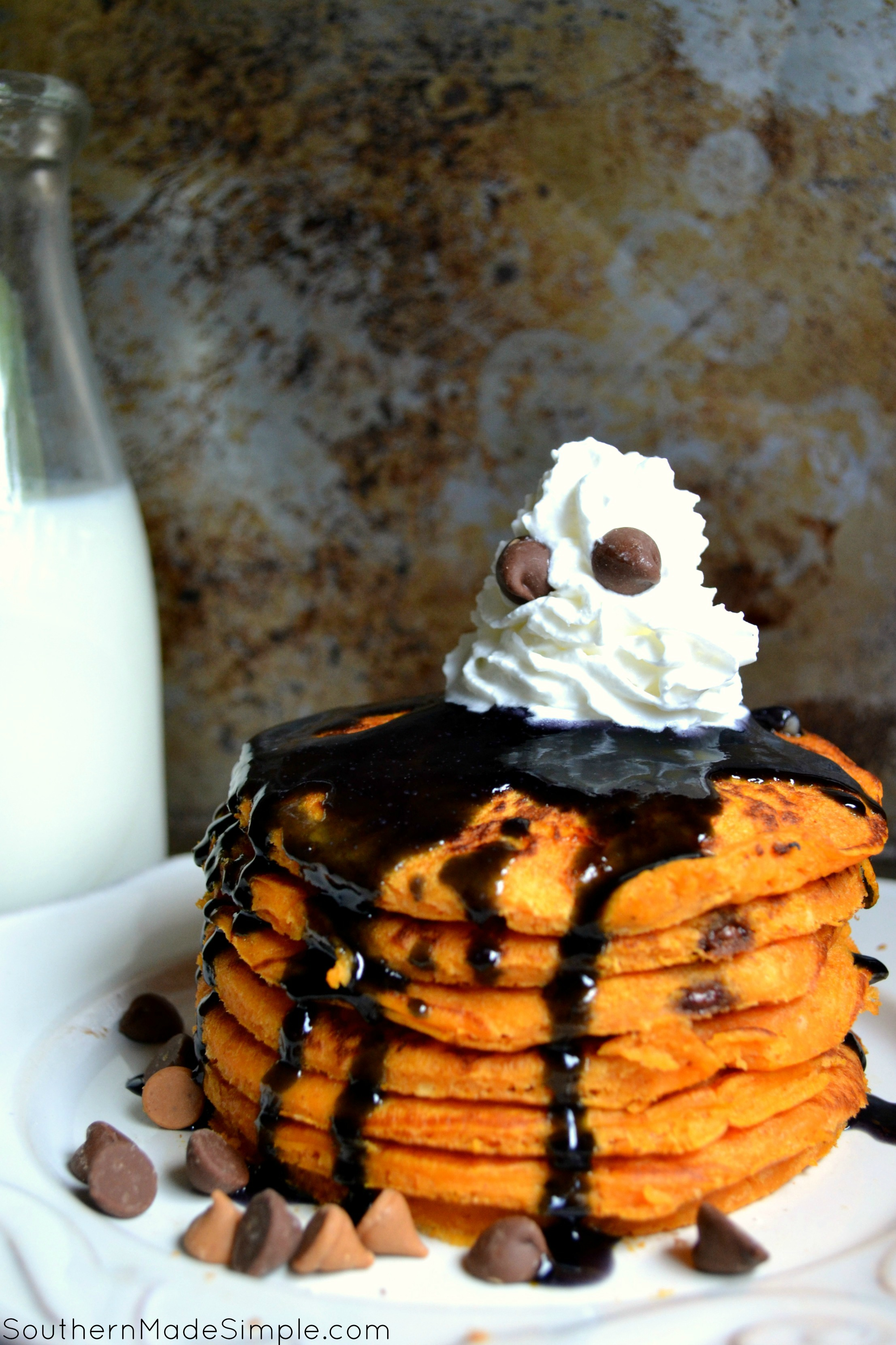 Haunted Halloween Pancakes | These SUPER simple pumpkin pancakes make for a perfect Halloween morning treat!