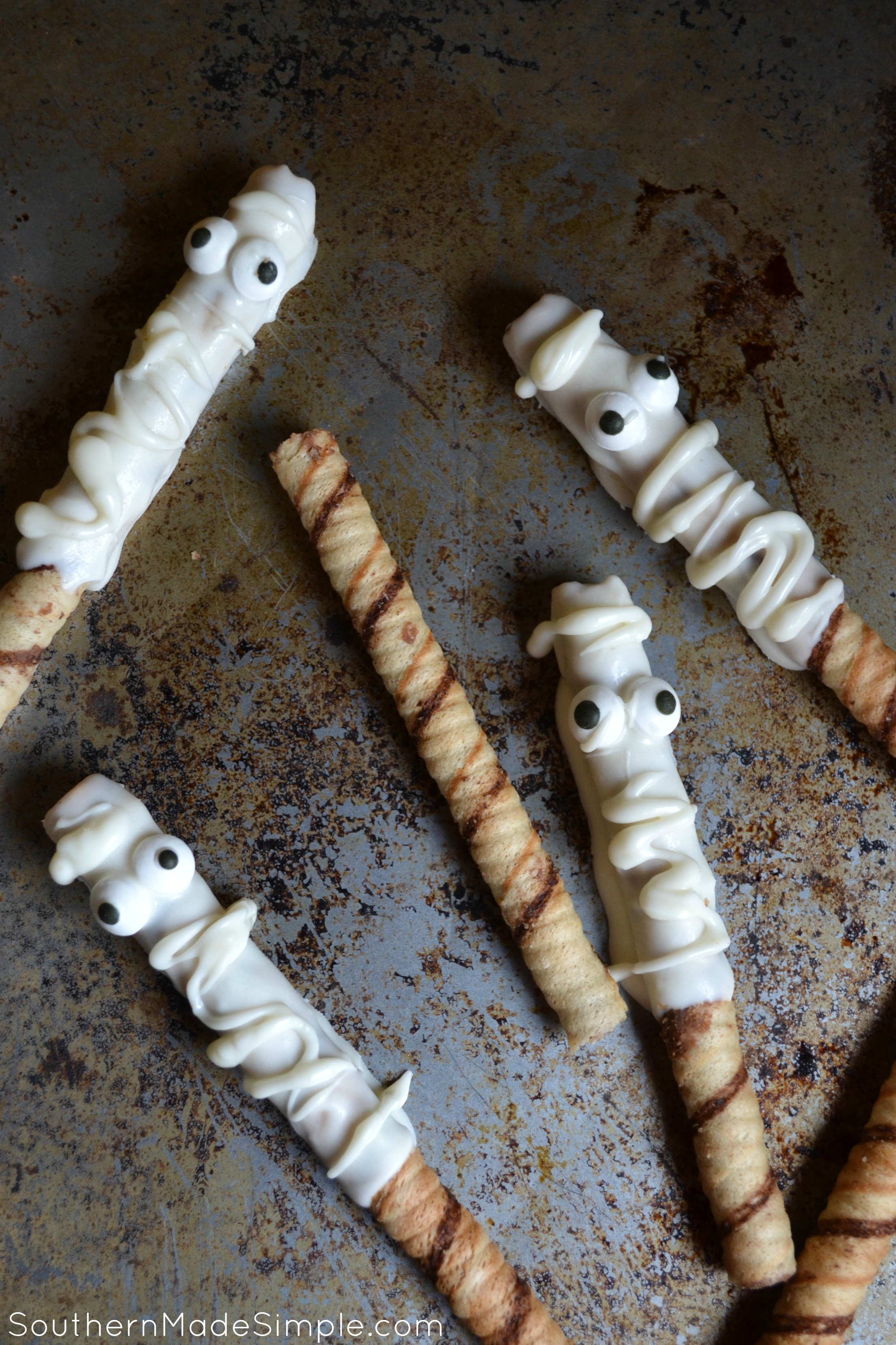 Halloween Mummy Treats - Chocolate dipped hazelnut prioulines mummified with Halloween goodness!