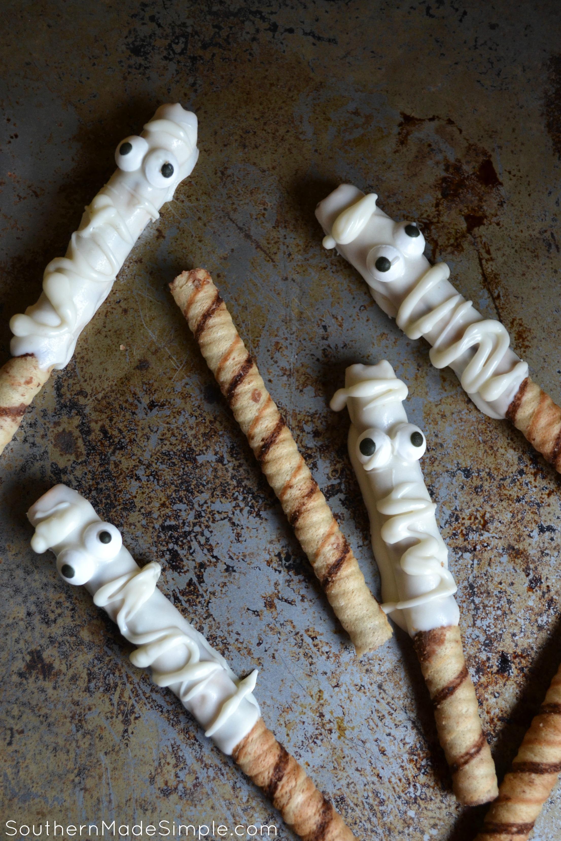 Halloween Mummy Treats - Chocolate dipped hazelnut prioulines mummified with Halloween goodness!