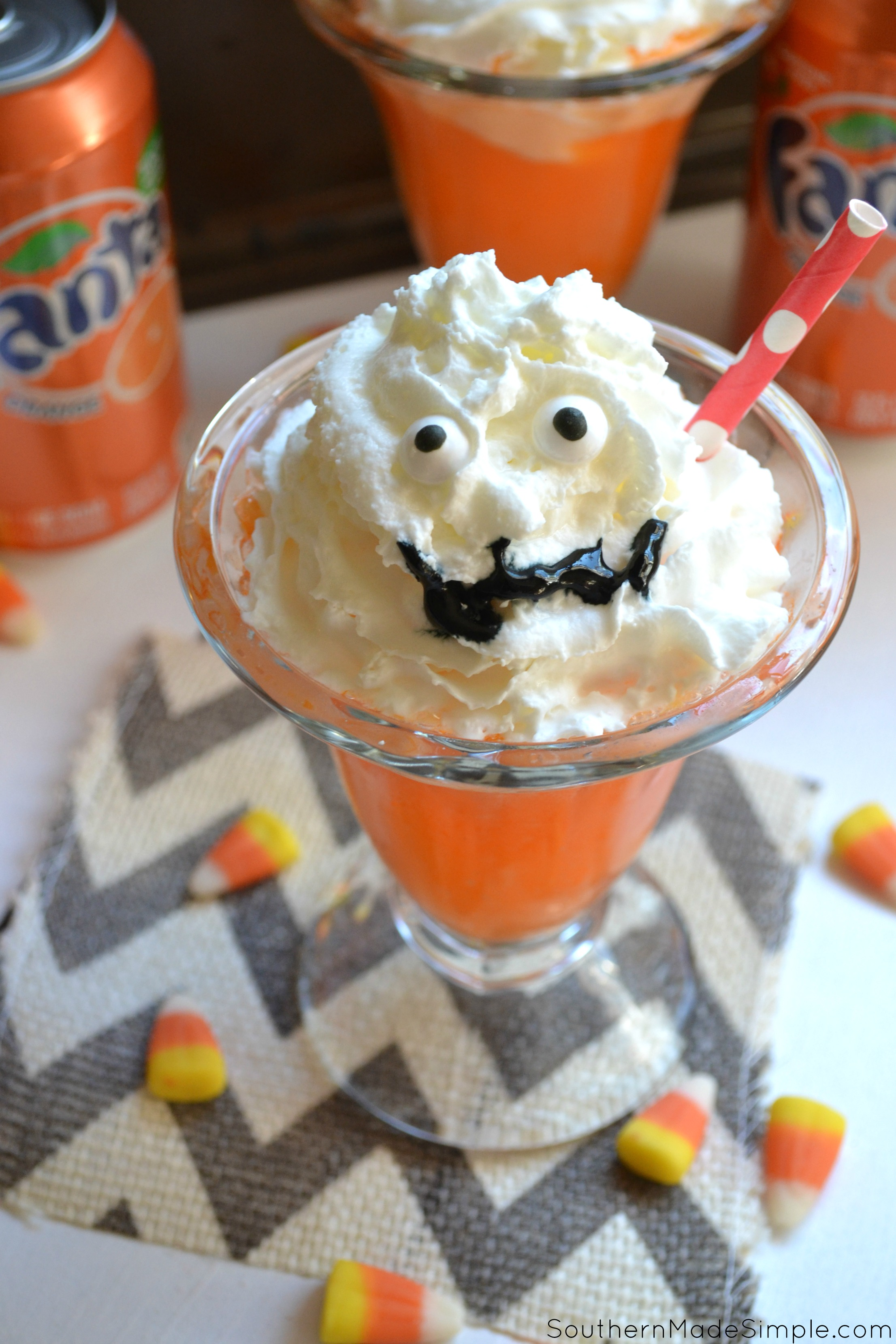 These cute little Orange Fanta Scram-scicle floats are the perfect treat to serve for a hauntingly awesome Halloween! They're simple to make and even more fun to devour...if you dare! #WickedFantaFun #ad