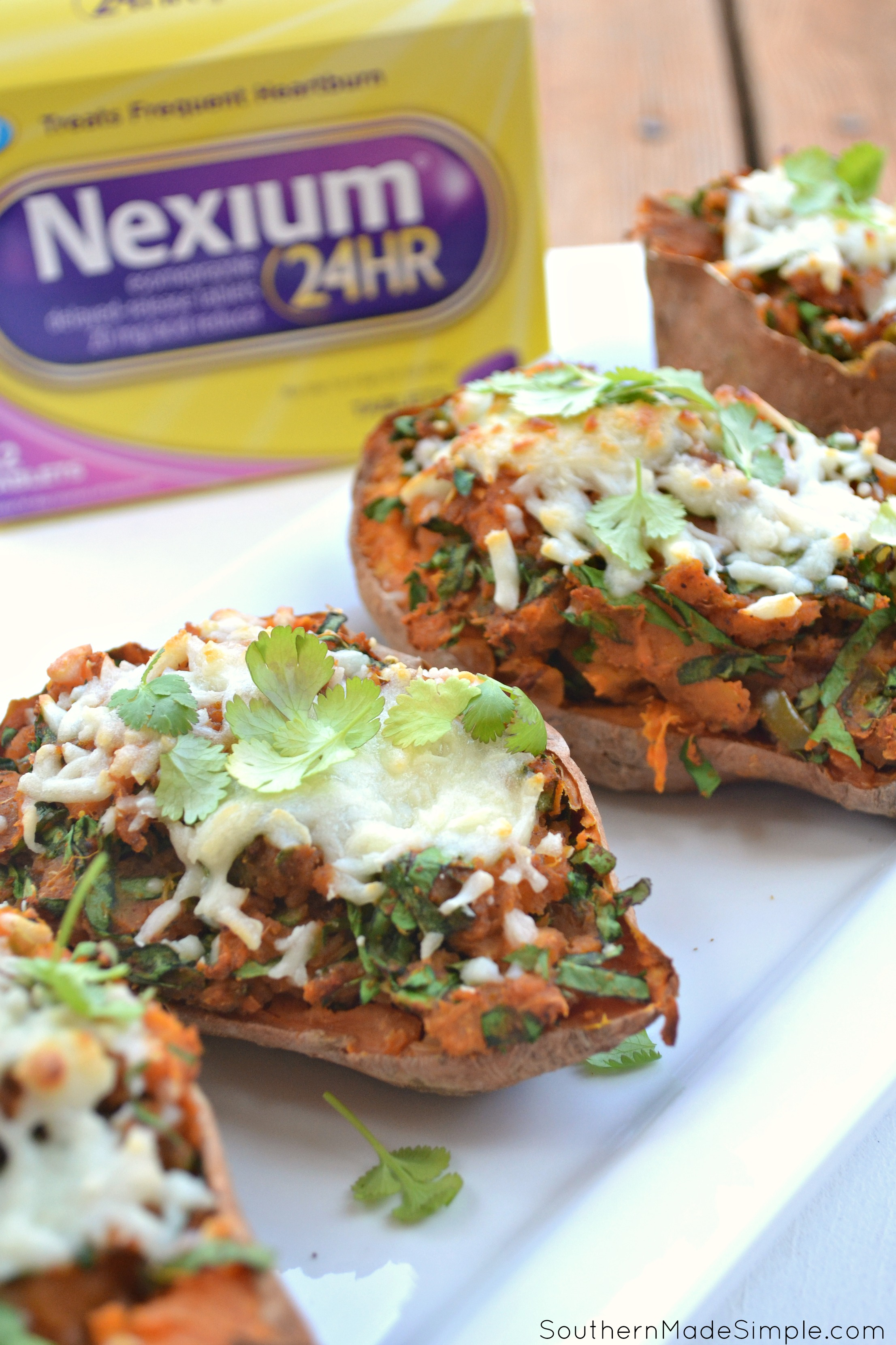 Looking for a delicious and unique way to spice up your Thanksgiving menu? These Spicy Twice Baked Sweet Potatoes are just the thing you've been looking for! #MakeHeartburnHistory #ad