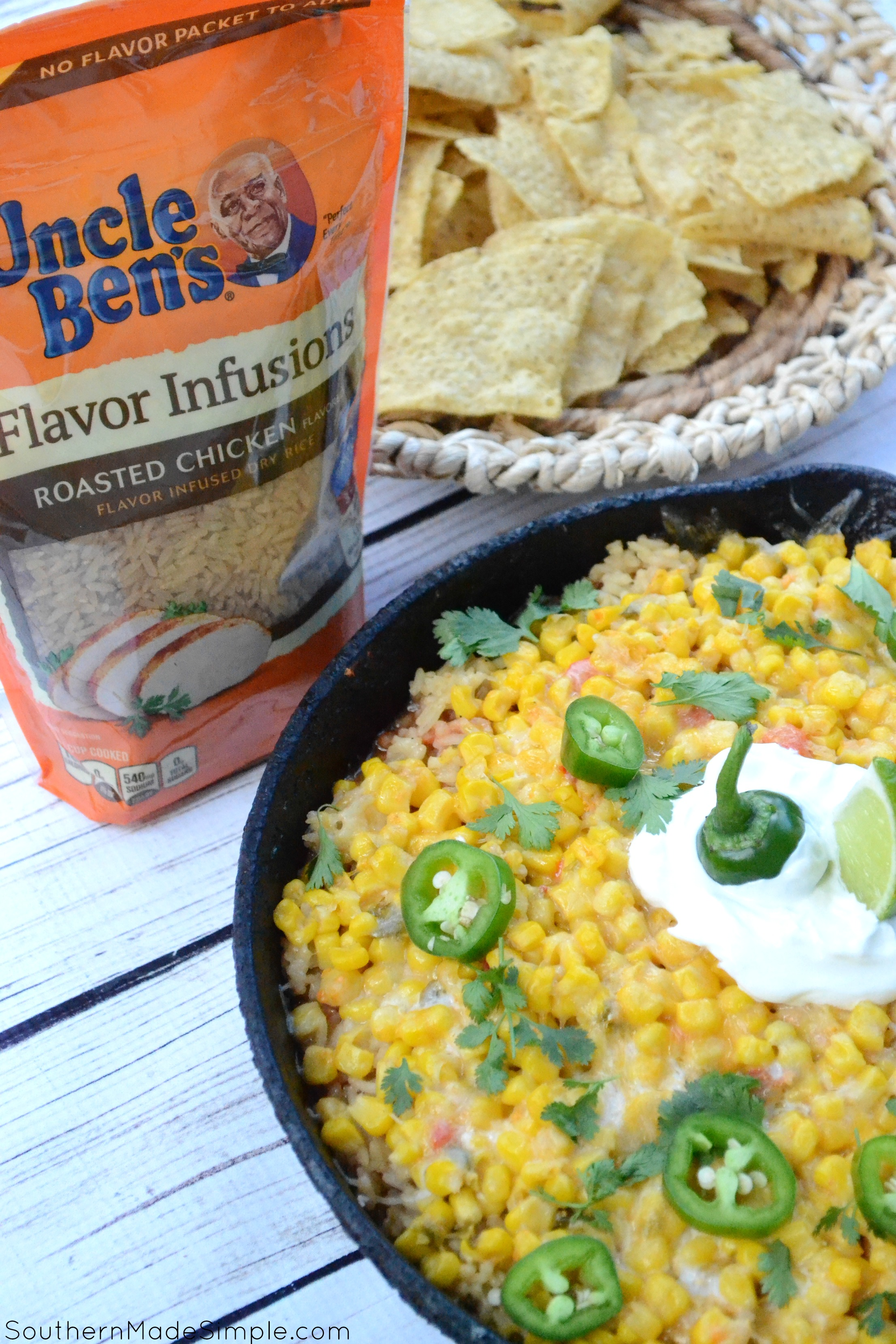"""Looking for a quick and easy weeknight meal to take your """"Taco Tuesday"""" to a whole new level? This Cheesy Chicken & Rice Burrito Dip is ready in 30 minutes, only requires one pan and will become a family favorite after the very first bite! #UncleBens #FlavorInfusions #ad"""