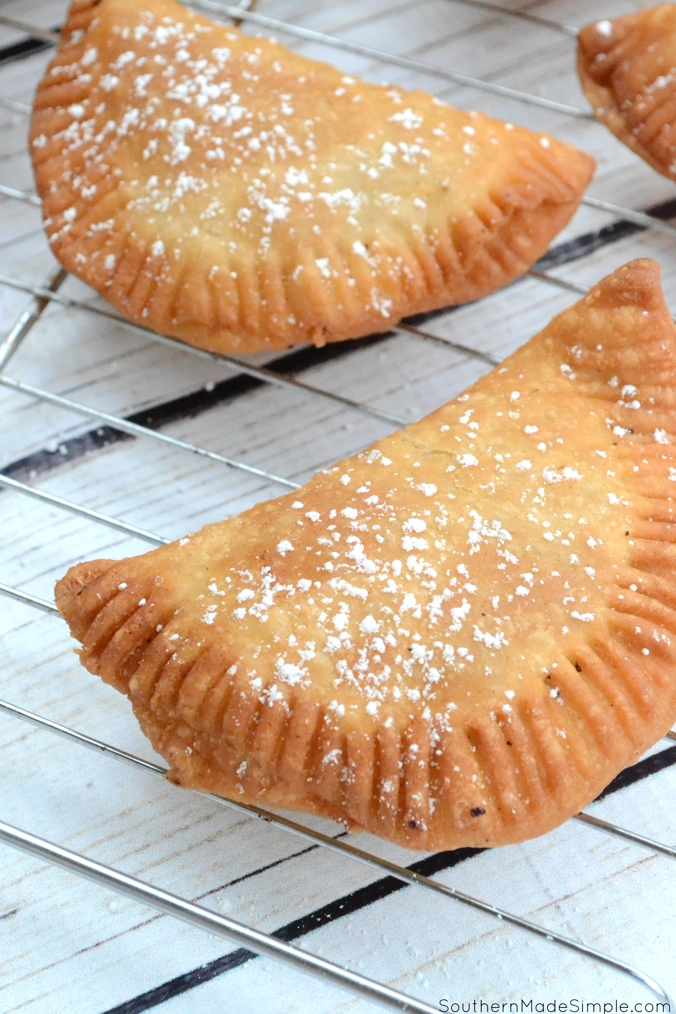 There's nothing better than taking a big of a flaky warm fried peach pie on those hot summer days, and this recipe for Southern Fried Peach Hand Pies is sure to be just the thing you need to make your summer extra sweet! #CreateWithOil #ad