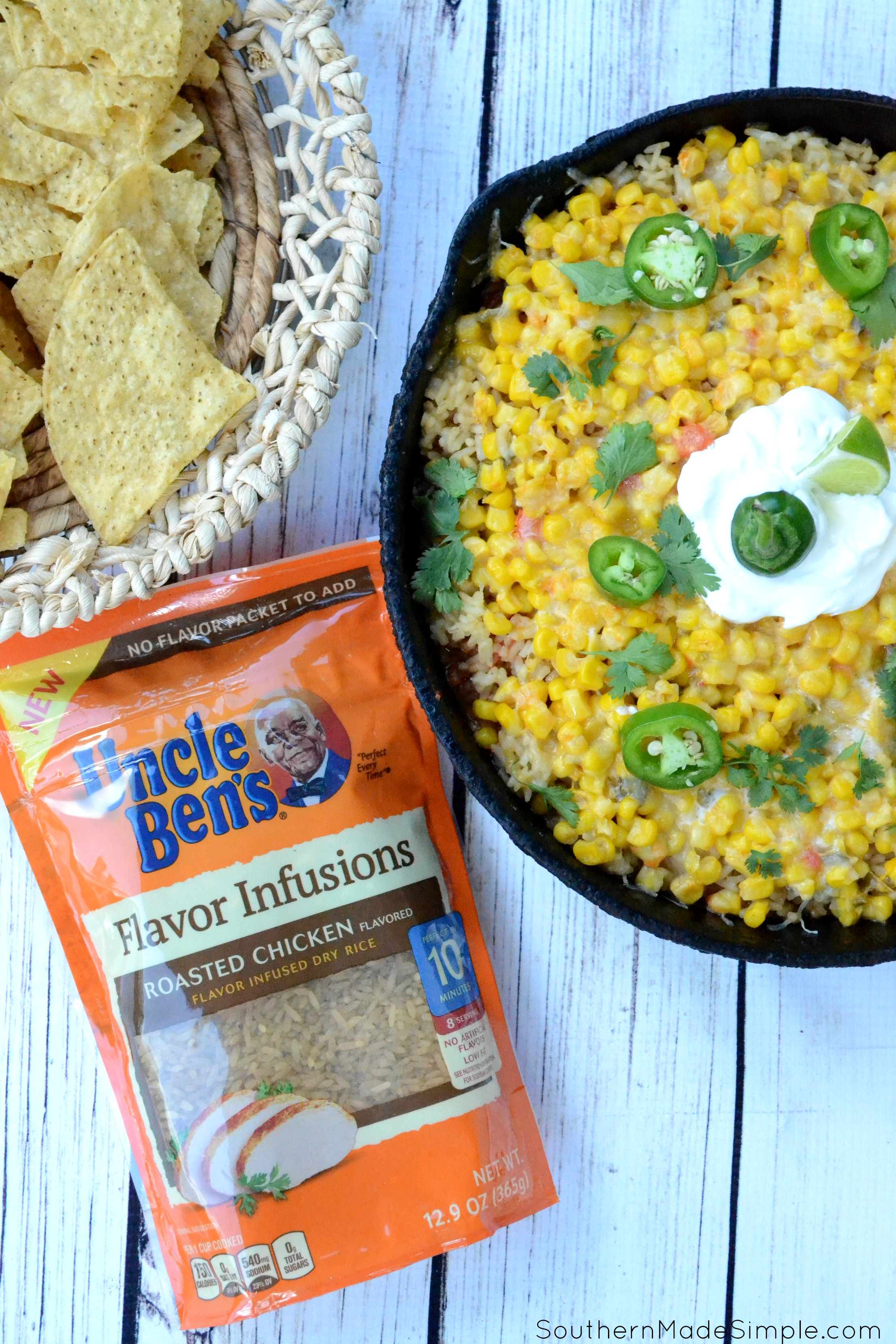 "Looking for a quick and easy weeknight meal to take your ""Taco Tuesday"" to a whole new level? This Cheesy Chicken & Rice Burrito Dip is ready in 30 minutes, only requires one pan and will become a family favorite after the very first bite! #UncleBens #FlavorInfusions #ad"
