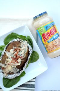 There's nothing better than a baked potato loaded with delicious cheesy goodness, and these Cheesy Chicken & Spinach Alfredo Baked Potatoes are overflowing with the the creamiest alfredo sauce made by Ragu that will make you go back for seconds!