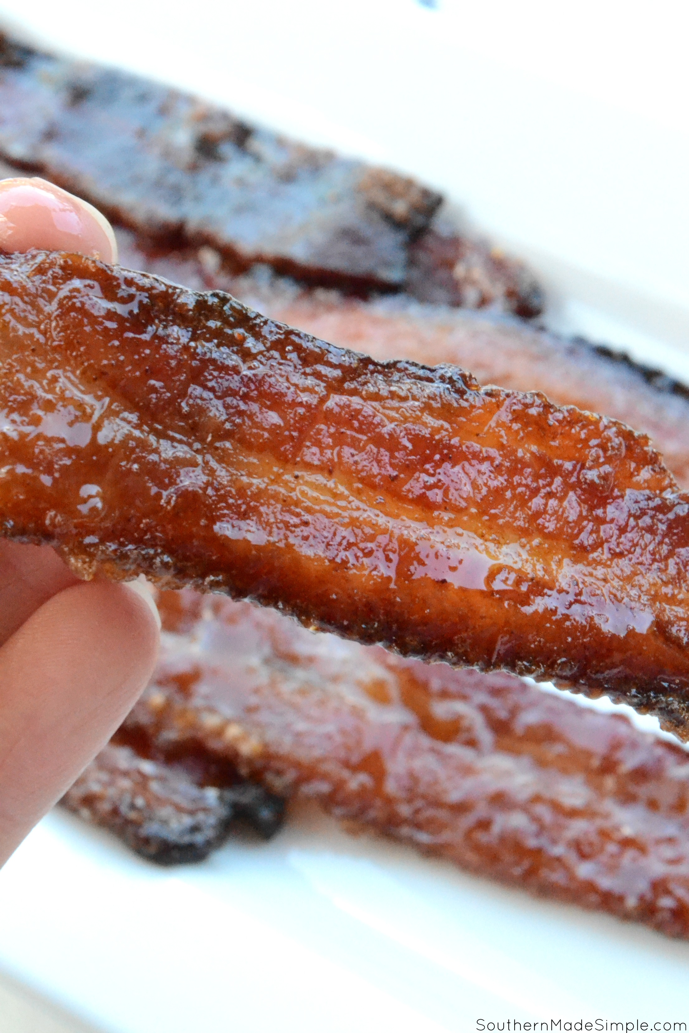 This super simple recipe for sweet and savory candied bacon with a hint of heat is so finger lickin' good, you'll want to make it all the time!