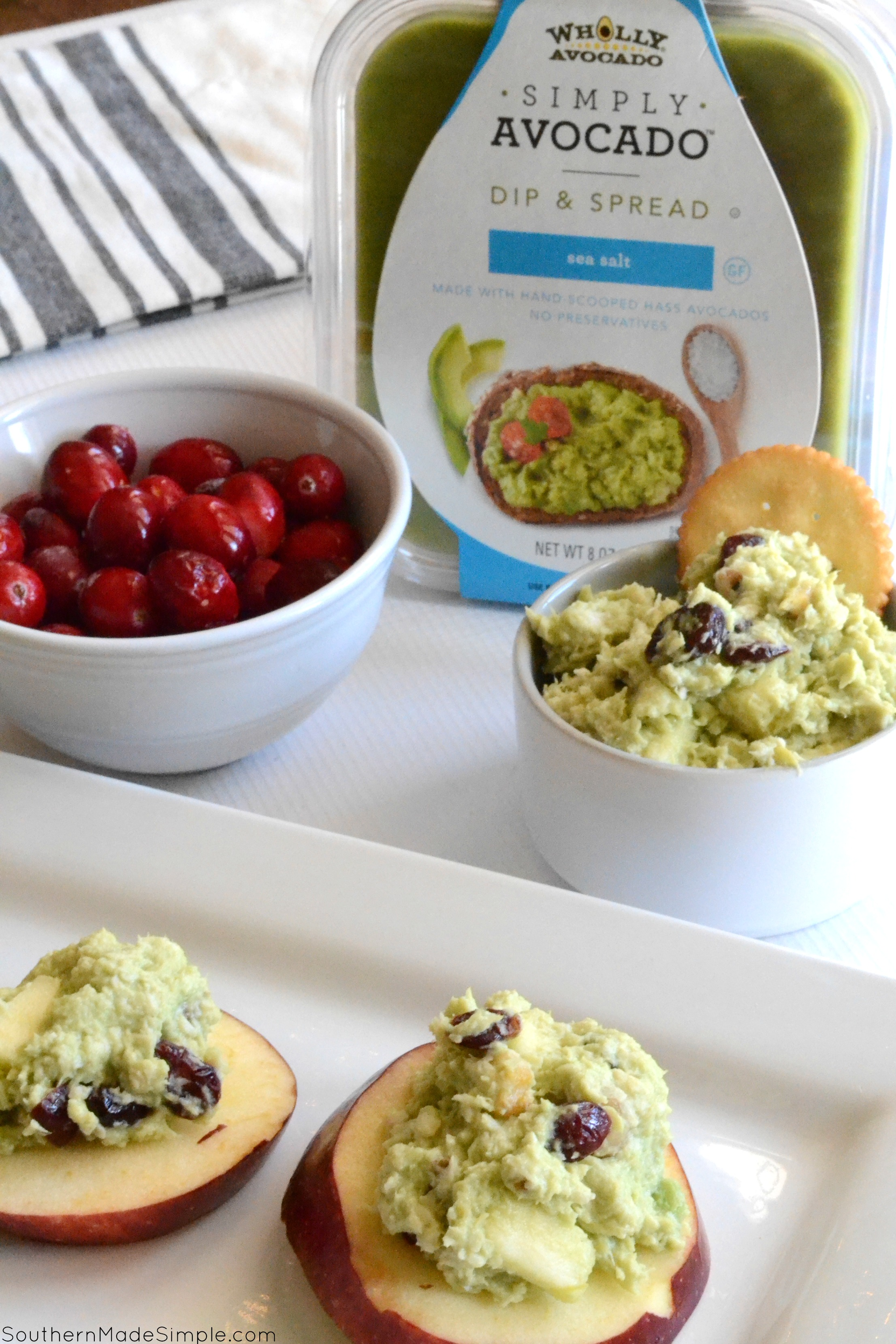 Need a quick and easy mid-day snack or a simple lunch on the go packed with goodness? This recipe for Cranberry-Avocado Chicken Salad is light, delicious and can come together in just a few minutes! Serve it on apple slices, with crackers, in a tortilla or on bread, the possibilities are endless! #SimplyAvocado #Ad