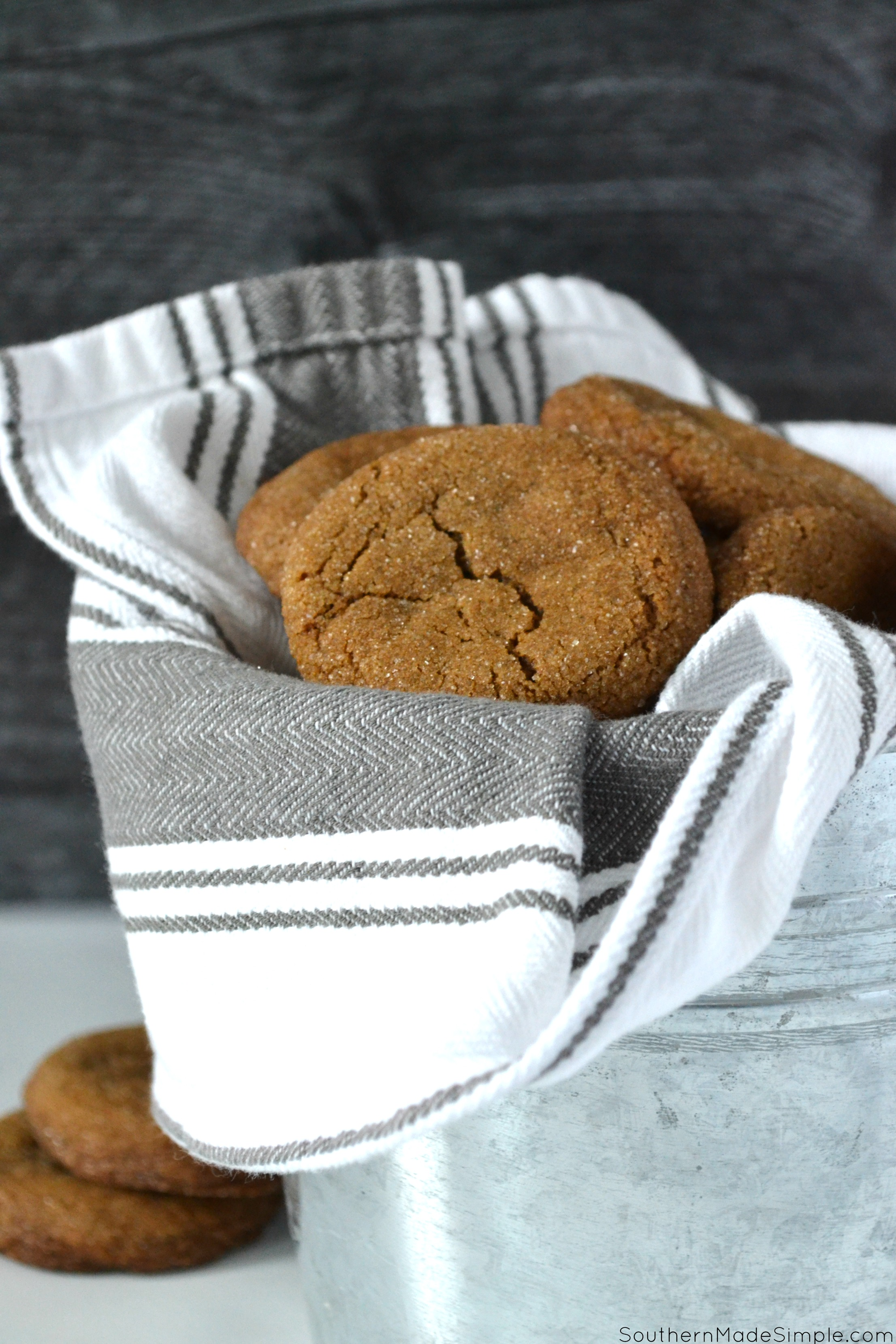 These Molasses Sugar Cookies are crisp on the outside, chewy on the inside and coated in sweet sugar crystals. They make the whole house smell like christmas when they're in the oven, and you definitely can't eat just one! #molassescookies