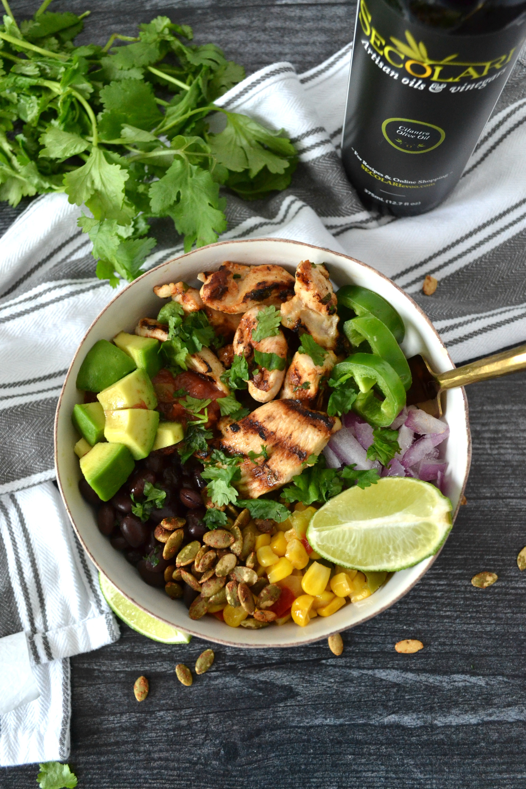 Cilantro Lime Chicken Taco Bowls are a perfect weeknight meal to celebrate your favorite night of the week: Taco Tuesday! Using Secolari Artisan Cilantro Olive Oil, the rich flavors of pressed cilantro in the grilled chicken really come to life! #ad