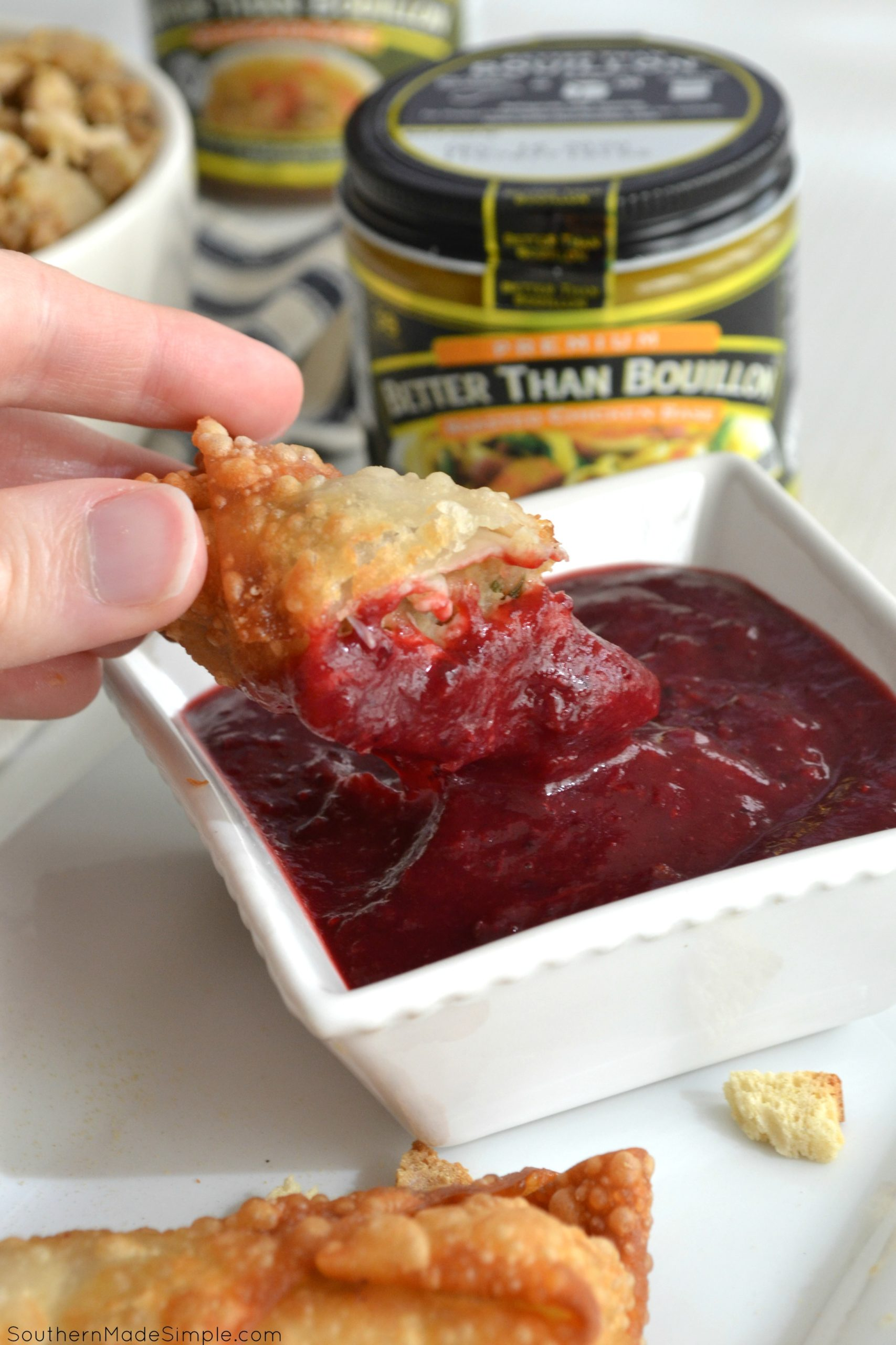 These Turkey and Dressing Stuffed Egg Rolls with Cranberry Dipping Sauce are the perfect twist to the classic Thanksgiving dish, and they're bursting with flavor from a smidge of Better Than Bouillon! #ad #HolidaysWithBTB #BTBHolidayRecipes #IC